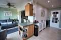 Exended living/dining/kitchen area
